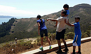Lawrence father Syed Jamal, pictured here with his children, was arrested last week and is now facing deportation after more than 30 years living in the U.S. In this photo, the research scientist enjoys a lighthearted moment with his daughter, Naheen, and sons Fareed (on shoulders) and Taseen, during a family vacation in California.