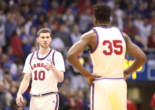 Kansas guard Sviatoslav Mykhailiuk (10) and Kansas center Udoka Azubuike (35) have a talk at half court during the first half, Saturday, Feb. 3, 2018 at Allen Fieldhouse.