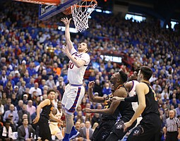 Kansas guard Sviatoslav Mykhailiuk (10) puts the ball off the glass during the first half, Saturday, Feb. 3, 2018 at Allen Fieldhouse.