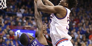 Kansas center Udoka Azubuike (35) puts a shot over TCU forward JD Miller (15) during the first half on Tuesday, Feb. 6, 2018 at Allen Fieldhouse.
