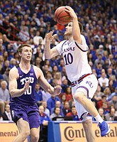 Kansas guard Sviatoslav Mykhailiuk (10) elevates to the bucket against TCU forward Vladimir Brodziansky (10) during the first half on Tuesday, Feb. 6, 2018 at Allen Fieldhouse.
