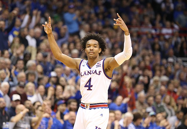 Kansas guard Devonte' Graham (4) raises up his hands after a three during the second half on Tuesday, Feb. 6, 2018 at Allen Fieldhouse.