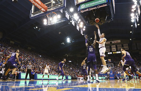 Kansas forward Mitch Lightfoot (44) turns for a shot over TCU forward Kouat Noi (12) during the first half on Tuesday, Feb. 6, 2018 at Allen Fieldhouse.