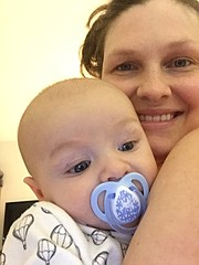 Laura Henderson holds her son, 4-month-old Grit Henderson, in this undated photo. Laura her husband Nolan Henderson are both teachers at Free State High School, where students and staff have recently led fundraising efforts in support of the family.
