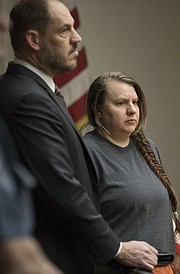 Christina Towell of Leavenworth, stands next to her attorney Michael Clarke during an appearance before Judge Kay Huff on Tuesday, Feb. 6, 2018 in Douglas County District Court.