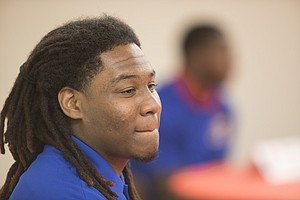 """Kansas defensive tackle Charles """"Codey"""" Cole takes questions from media members following head coach David Beaty's National Signing Day press conference on Wednesday, Feb. 7, 2018 at the Anderson Family Football Complex."""