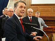 Gov. Jeff Colyer stood with representatives from the Kansas Press Association, Kansas Broadcasters Association and the Kansas Sunshine Coalition Thursday as he signed four executive orders aimed at increasing transparency in state government.
