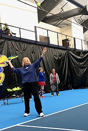 Grace Endacott Brooks, 85, of Lawrence, tosses a tennis ball into the air as she works on her serve during class Feb. 2, 2018 at the Jayhawk Tennis Center, 233 Rock Chalk Lane.