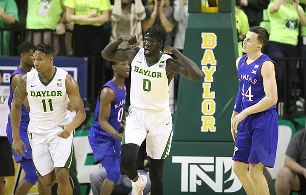 Baylor Bears forward Jo Lual-Acuil Jr. (0) flexes next to Kansas forward Mitch Lightfoot (44) after a bucket during the first half, Saturday, Feb. 11, 2018 at Ferrell Center in Waco, Texas.