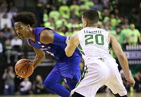 Kansas guard Devonte' Graham (4) tries to get around Baylor Bears guard Manu Lecomte (20) during the first half, Saturday, Feb. 11, 2018 at Ferrell Center in Waco, Texas.