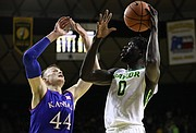 Baylor Bears forward Jo Lual-Acuil Jr. (0) turns for a shot against Kansas forward Mitch Lightfoot (44) during the second half, Saturday, Feb. 11, 2018 at Ferrell Center in Waco, Texas.