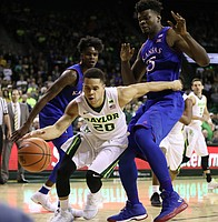 Baylor Bears guard Manu Lecomte (20) drives baseline against Kansas center Udoka Azubuike (35) and Kansas guard Lagerald Vick (2) during the second half, Saturday, Feb. 11, 2018 at Ferrell Center in Waco, Texas.