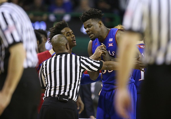 Kansas center Udoka Azubuike (35) is sent back to the bench by an official and his teammate Kansas guard Devonte' Graham (4) while protesting a call during the second half, Saturday, Feb. 11, 2018 at Ferrell Center in Waco, Texas.