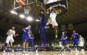 Baylor Bears forward Mark Vital (11) puts up a shot after drawing contact from Kansas center Udoka Azubuike (35) during the second half, Saturday, Feb. 11, 2018 at Ferrell Center in Waco, Texas.