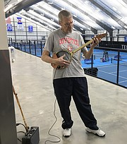 Scott Weir, of Topeka, plays his electric guitar made from a tennis racket on Feb. 2, 2018, which was the final day of the first session of senior tennis classes at the Jayhawk Tennis Center, 233 Rock Chalk Lane.