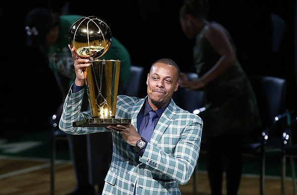 abc74c304a7 Former Boston Celtics Paul Pierce holds the NBA championship trophy that he  won with the team