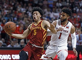 Iowa State's Lindell Wigginton (5) dribbles the ball around Texas Tech's Brandone Francis (1) during the first half of an NCAA college basketball game Wednesday, Feb. 7, 2018, in Lubbock, Texas.