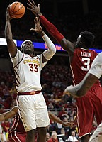 Iowa State forward Solomon Young (33) shoots over Oklahoma forward Khadeem Lattin, right, during the second half of an NCAA college basketball game, Saturday, Feb. 10, 2018, in Ames, Iowa.