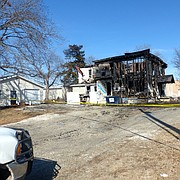 A fire Monday in Baldwin City destroyed the more than 100-year-old building at 215 N. Sixth St. that was the home of CopperLeaf Gourmet Foods.