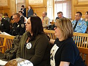 Heather Joyce, left, and Theresa Wynne, the sister-in-law and mother respectively of Dominique White, who was shot and killed by Topeka police officers in September, listen Tuesday, Feb. 13, 2018 during testimony in a Senate committee on a bill that would require law enforcement to provide public access to police camera audio and video in certain circumstances.