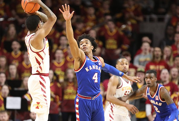 Kansas guard Devonte' Graham (4) defends against a shot from Iowa State guard Donovan Jackson (4) during the first half, Tuesday, Feb. 13, 2018 at Hilton Coliseum in Ames, Iowa.
