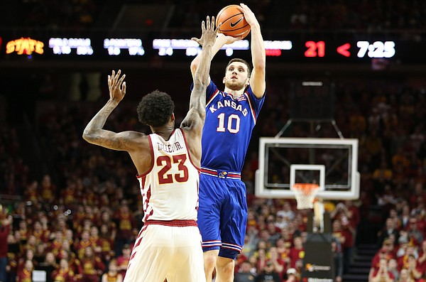 Kansas guard Sviatoslav Mykhailiuk (10) pulls up for a three in front of Iowa State forward Zoran Talley Jr. (23) during the first half, Tuesday, Feb. 13, 2018 at Hilton Coliseum in Ames, Iowa.
