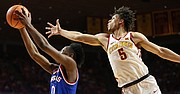 Kansas guard Marcus Garrett (0) extends to the bucket as Iowa State guard Lindell Wigginton (5) hovers over during the first half, Tuesday, Feb. 13, 2018 at Hilton Coliseum in Ames, Iowa.