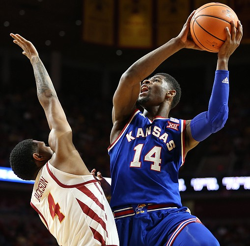 Kansas guard Malik Newman (14) puts up a shot after a foul from Iowa State guard Donovan Jackson (4) during the first half, Tuesday, Feb. 13, 2018 at Hilton Coliseum in Ames, Iowa.