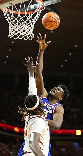 Kansas center Udoka Azubuike (35) puts a shot over Iowa State forward Solomon Young (33) during the second half, Tuesday, Feb. 13, 2018 at Hilton Coliseum in Ames, Iowa.