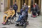 Maurice Evans, left, Blake Hunt, center, and Angel Martinez leave federal court after attending a hearing Wednesday, Feb. 14, 2018, in New York. The three attended to show their support for a lawsuit that claims the government's decision to classify marijuana as dangerous is irrational, unconstitutional and motivated by politics, not hard science. (AP Photo/Mark Lennihan)