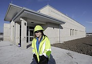 Melinda Harger, utilities engineer with the City of Lawrence, passes by the new administration building at the new Wakarusa Wastewater Treatment Plant, 2300 E. 41st St., Tuesday, Feb. 13, 2018.