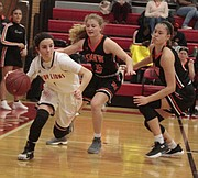 Lawrence High junior Hannah Stewart dribbles navigates her way through Shawnee Mission Northwest's full-court press in the second half of the Lions' 51-45 win over the Cougars on Tuesday at LHS.