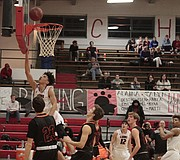 Lawrence High junior Trey Quartlebaum goes up for a layup in the first half of the Lions' 77-51 win over Shawnee Mission Northwest on Tuesday at LHS.
