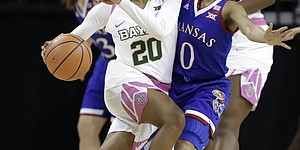 Baylor guard Juicy Landrum (20) works against Kansas guard Christalah Lyons (0) in the first half of an NCAA college basketball game Saturday, Feb. 17, 2018, in Waco, Texas. (AP Photo/Tony Gutierrez)