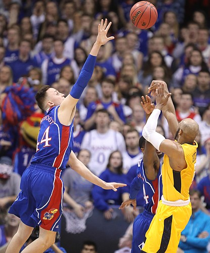 Kansas forward Mitch Lightfoot (44) defends against a shot from West Virginia guard Jevon Carter (2) during the first half, Saturday, Feb. 17, 2018 at Allen Fieldhouse.