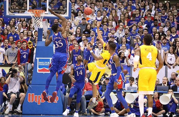 Kansas center Udoka Azubuike (35) gets up to block a shot from West Virginia forward Esa Ahmad (23) during the second half, Saturday, Feb. 17, 2018 at Allen Fieldhouse.