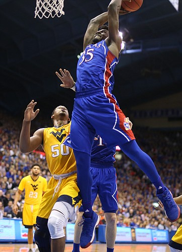 Kansas center Udoka Azubuike (35) reaches for a ball above West Virginia forward Sagaba Konate (50) during the second half, Saturday, Feb. 17, 2018 at Allen Fieldhouse.