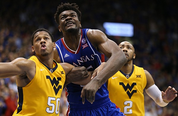 Kansas center Udoka Azubuike (35) fights for position with West Virginia forward Sagaba Konate (50) and West Virginia guard Jevon Carter (2) during the second half, Saturday, Feb. 17, 2018 at Allen Fieldhouse.
