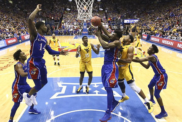 Kansas center Udoka Azubuike (35) pulls a rebound from West Virginia forward Sagaba Konate (50) during the second half, Saturday, Feb. 17, 2018 at Allen Fieldhouse.