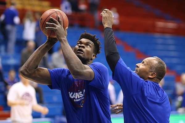 Kansas center Udoka Azubuike (35) spins off assistant coach Norm Roberts during pregame warmups, Monday, Feb. 19, 2018 at Allen Fieldhouse.