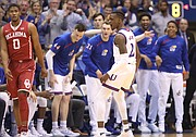 Kansas guard Lagerald Vick (2) celebrates after a three during the first half, Monday, Feb. 19, 2018 at Allen Fieldhouse. At left is Oklahoma guard Christian James (0).