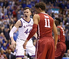 Kansas forward Mitch Lightfoot (44) celebrates after a dunk during the first half, Monday, Feb. 19, 2018 at Allen Fieldhouse.