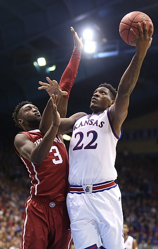 Kansas forward Silvio De Sousa (22) turns to the bucket past Oklahoma forward Khadeem Lattin (3) during the second half, Monday, Feb. 19, 2018 at Allen Fieldhouse.