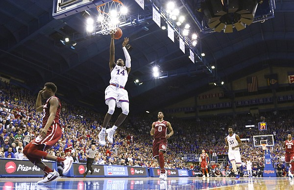 Kansas guard Malik Newman (14) soars in for a bucket during the second half, Monday, Feb. 19, 2018 at Allen Fieldhouse.