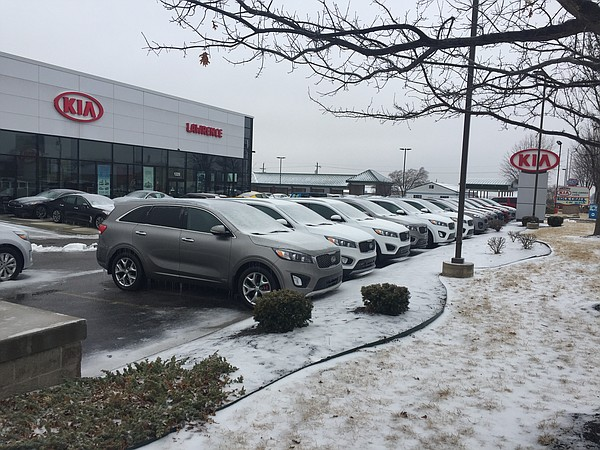 Lawrence's Kia dealership on 23rd Street is set to expand into space currently occupied by Rock Chalk Car Wash, which is visible in the background.