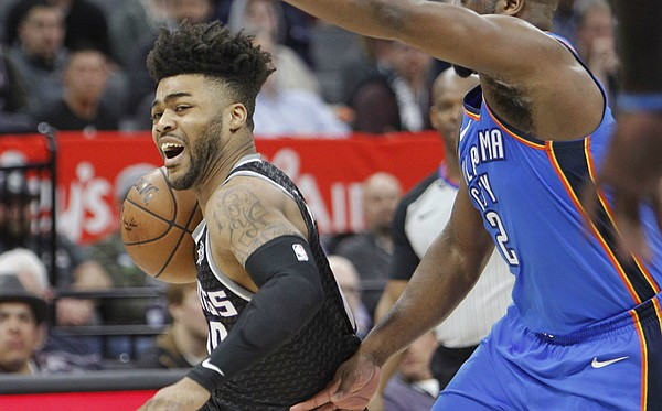 Sacramento Kings guard Frank Mason III (10) drives to the basket around Oklahoma City Thunder guard Raymond Felton (2) during the second half of an NBA basketball game in Sacramento, Calif., Thursday, Feb. 22, 2018. The Thunder won 110-107. (AP Photo/Steve Yeater