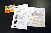 This test kit from Molecular Fitness includes instructions for swabbing your cheeks to collect DNA samples and envelopes in which to pack the samples to send them to the lab. The swabs come wrapped in sterile packages.