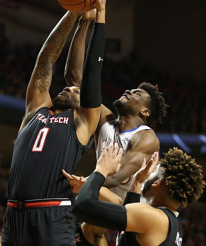 Kansas center Udoka Azubuike (35) fights for a rebound with Texas Tech forward Tommy Hamilton IV (0) during the first half on Saturday, Feb. 24, 2018 at United Supermarkets Arena.