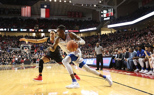 Kansas guard Lagerald Vick (2) drives the baseline against Texas Tech guard Zhaire Smith (2) during the second half on Saturday, Feb. 24, 2018 at United Supermarkets Arena.