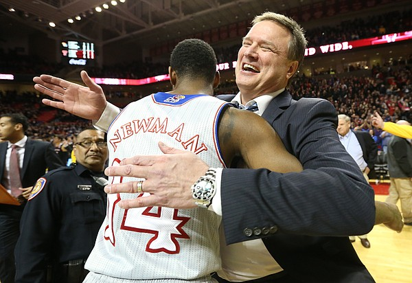 Kansas head coach Bill Self gives a hug to Kansas guard Malik Newman (14) following the Jayhawks' 74-72 win over Texas Tech on Saturday, Feb. 24, 2018 at United Supermarkets Arena. Newman helped force a Tech turnover on one of the final possessions.